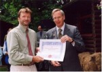 Terry receives a certificate on behalf of the Trustees of Stinchcombe Hill Recreation Ground Trust.